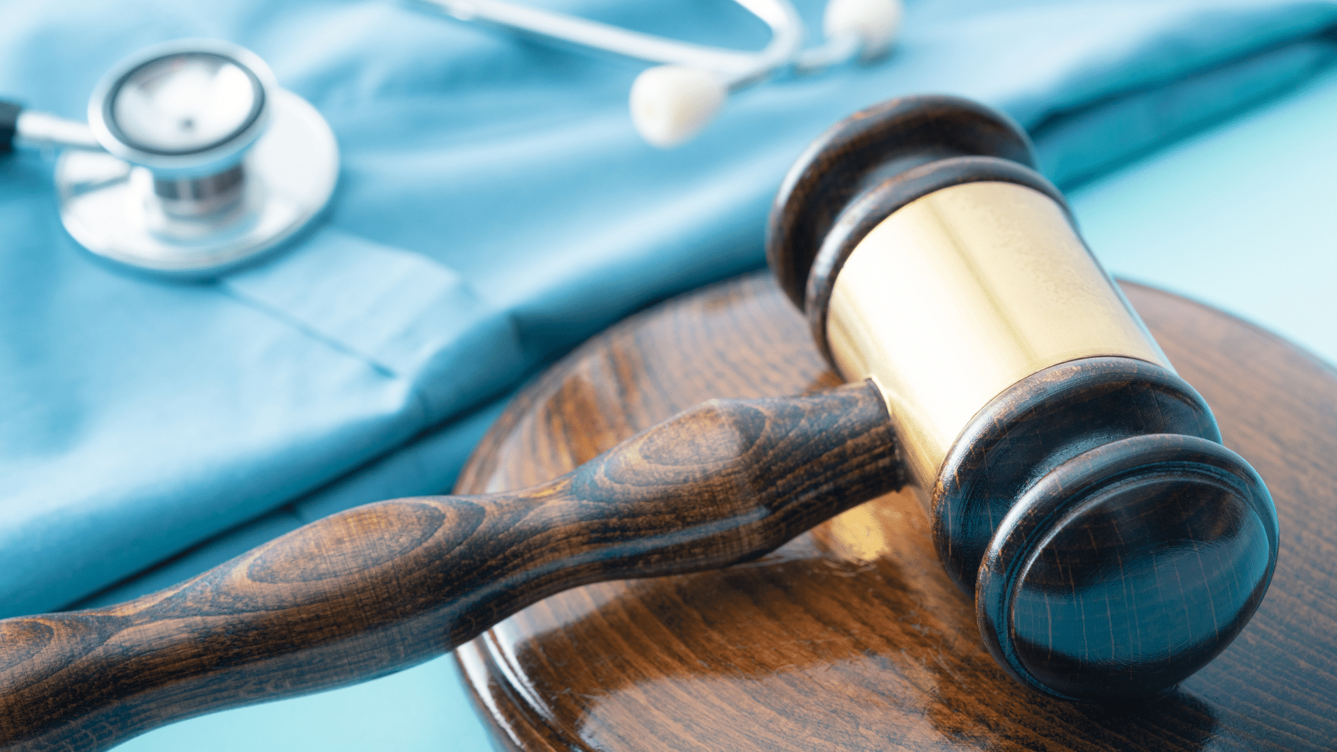 Gavel and stethoscope in background
