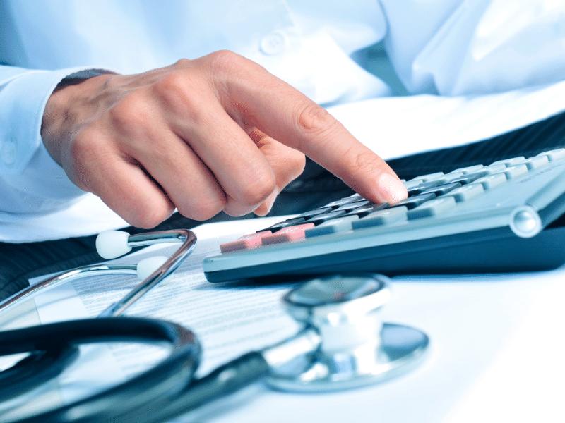 doctor using calculator