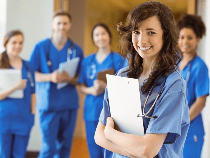 medical students smiling at camera