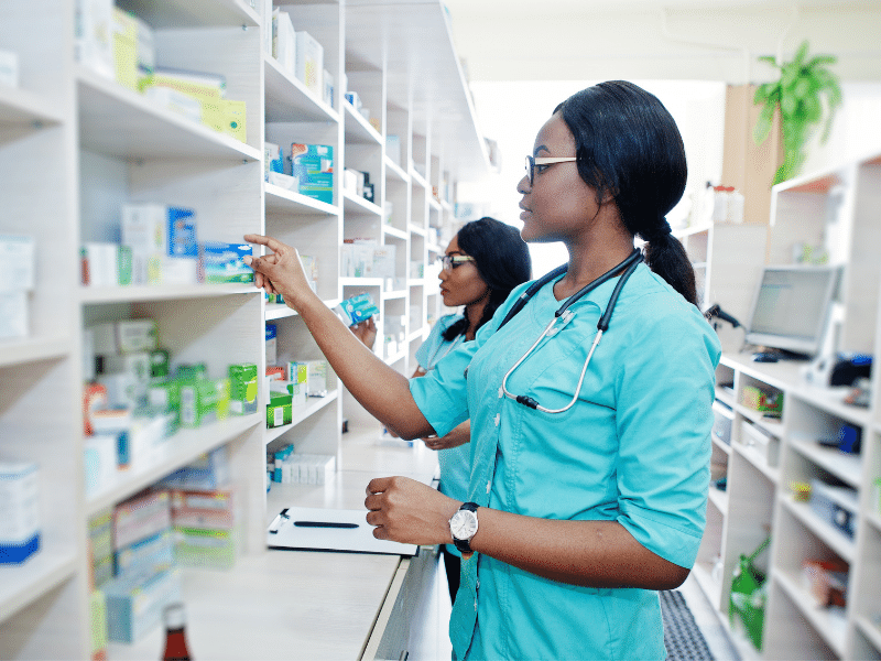 pharmacists working behind the counter